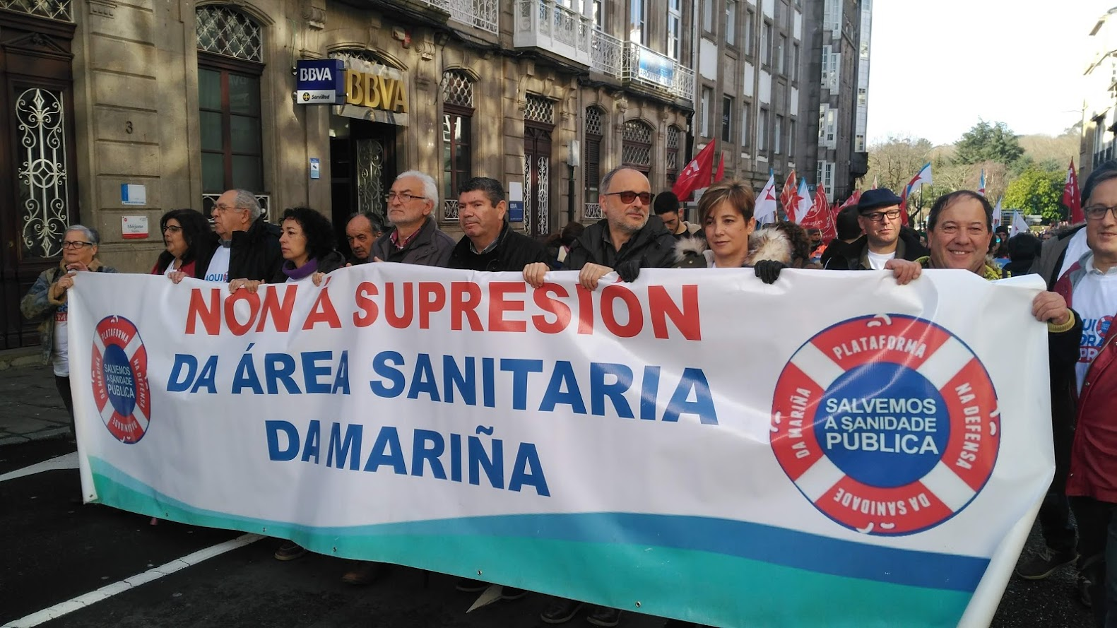 Pancarta contra a supresión da área sanitaria da Mariña na manifestación de Santiago