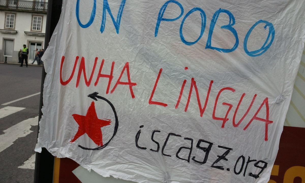 Cartel de Isca ao paso da manifestación